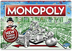 Monopoly board games with big silver pieces on the cover
