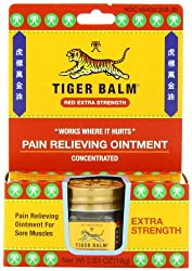 A small container of Tiger Balm medicated rub.