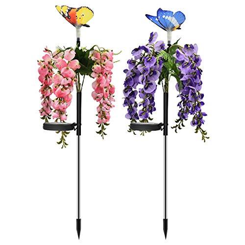 Decoratieve paarse bloemen op zonne-energie in het midden van de bloemen in graslicht met kunstbloemenlicht voor de tuin, verlichting voor de tuin, decoratie