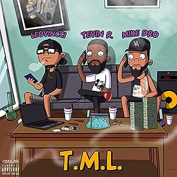 T.M.L.