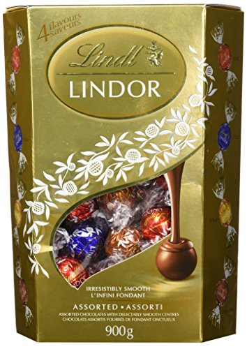 Lindt Lindor Assorted Chocolate Truffles, Value Pack, 900gram/1.98pound. Assortment of 4 Flavors of Chocolate Truffles : Hazelnut, Milk, White and...