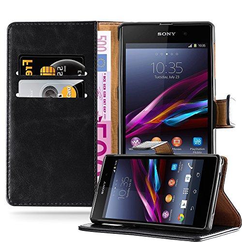 Cadorabo Funda Libro para Sony Xperia Z1 en Negro Grafito - Cubierta Proteccíon con Cierre Magnético, Tarjetero y Función de Suporte - Etui Case Cover Carcasa