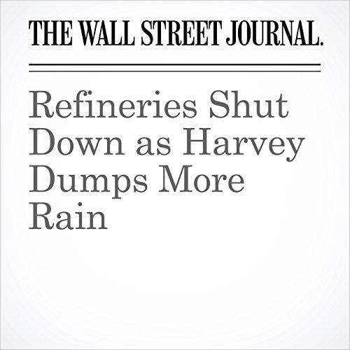 Refineries Shut Down as Harvey Dumps More Rain copertina