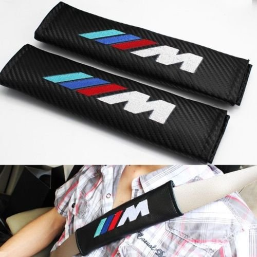 Almohadillas para cinturón de seguridad de carbono con emblema M Power bordado.
