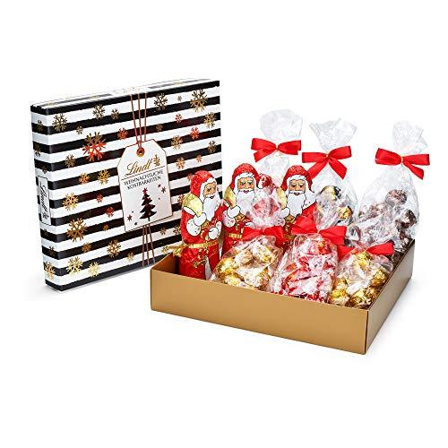 Lindt Schokoladengeschenk Black & White, Weihnachts-Schokolade, Weihnachtsmann und Lindor Kugeln Milch, Weiß, Dark 70% und Zimt & Koriander, 1.275kg