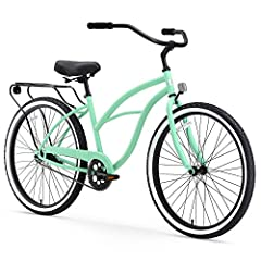 Classic, curvy Women's beach cruiser bicycle with 14-inch durable steel frame; ideal for casual, comfortable riding around the neighborhood Upright riding style keeps your back and shoulders comfortable; dual-spring saddle and wide cruiser handlebar ...