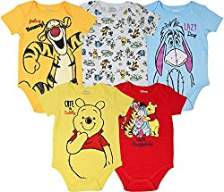"""Disney Winnie the Pooh newborn and infant pack of 5 cute and stylish short sleeve graphic creepers featuring lovable characters Pooh, Tigger, Eeyore and Piglet Yellow bodysuit: Pooh with the words """"Cute & cuddly""""; Orange bodysuit: Tigger with the wor..."""