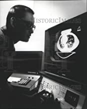 Historic Images - 1978 Press Photo Looking Over Images from an x-ray CT/T Scanner System