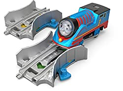 """Turbo Thomas Pack includes Thomas motorized toy train and two Booster Tracks Flip the switch on the Booster Tracks to change the colour from green to yellow To make Thomas travel in faster """"Turbo"""" mode, send him over the Booster Track while it's s..."""