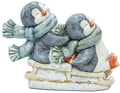 hLine Winter Dekoration 2 Pinguine auf Schlitten mit Schal Winterkind