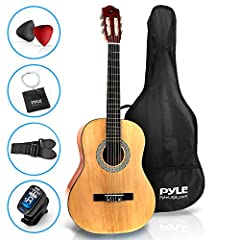 "36"" BEGINNER GUITAR SET: Pyle brings you a complete all-in-one acoustic guitar set, everything you need to start playing. The guitar comes with a gig bag case, pitch pipe tuner, spare strings, pearloid picks, cleaning cloth, and a gift card JUNIOR SC..."