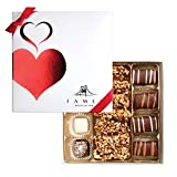 MOUTHWATERING INDULGENCE IN EVERY BITE – EXQUISITE CHOCOLATE GIFT: The chocolate fanatic will revel in this splendid assortment of gourmet chocolates. This elegant box includes five flavors: Viennese crunch; coconut caramel; soft blend; white coconut...