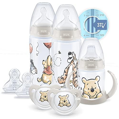 NUK Disney First Choice+ First Years Set | 0+ Monate | Temperaturkontrolle | 2 x 300ml Flaschen, 1 x Lernbecher, 2 x Schnuller, 2 Sauger | Anti-Colic Vent | BPA-frei | Winnie-the-Pooh | 7 Stück