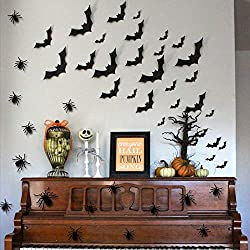 Halloween decorations and bat wall stickers above a piano.