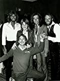 Celebrity Photos Candid The Bee Gees Posing with a Group
