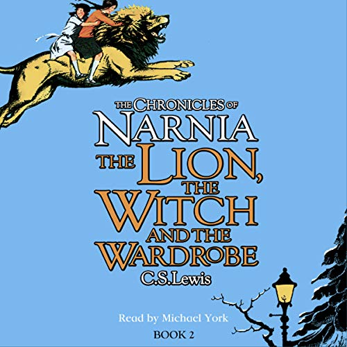 The Lion, the Witch and the Wardrobe: The Chronicles of Narnia cover art. A lion carrying two children leaps across the top left corner, and a streetlamp illuminates the bottom right. The background is blue and the title in yellow and orange.