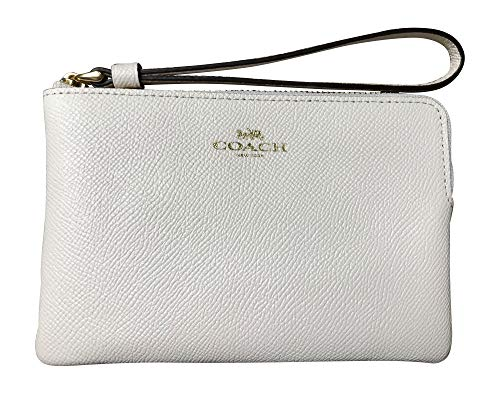 """Crossgrain leather with light gold hardware Interior features two credit card slip pockets Corner zip closure with attached wristlet strap Approximate dimensions: 6.25"""" x 4"""" x .5"""" Imported"""