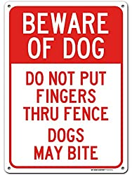 Do Not Put Fingers Thru Fence Dogs May Bite Sign