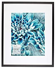 Black 16x20 wall frame with modern single white mat opening for a 11x14 image Contemporary narrow frame profile and flex tab back opening allowing you to easily add and remove photos or art Each frame includes ready-to-hang durable hangers on the bac...