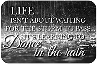 Life Isn't About Waiting for the Storm to Pass...It's Learning to Dance in the Rain. 12x8-inch Decorative Wood Sign.
