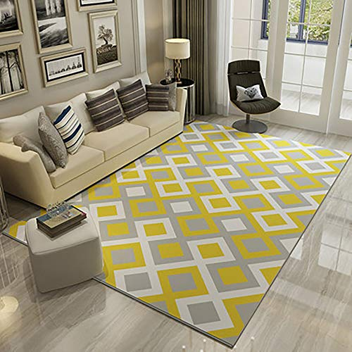 Alfombra amarilla y gris para salón con diseño geométrico