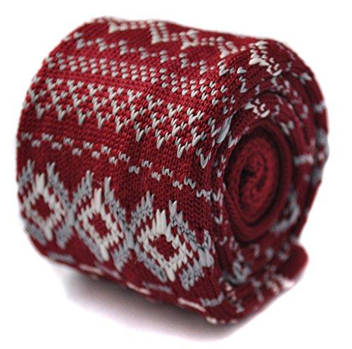 Frédéric Thomas cravate rouge tricotée avec pull de Noël