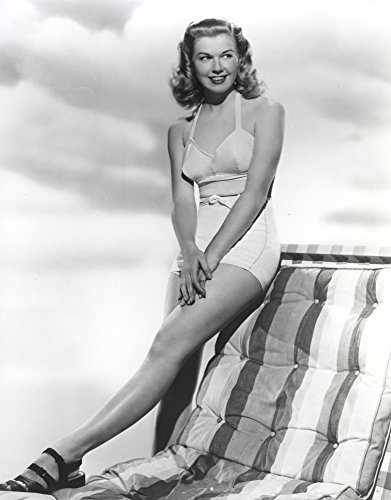 Doris Day Seated in Swimsuit Photo Print (8 x 10)