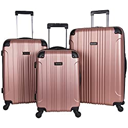 Rose gold Kenneth Cole suitcases - these make great luxury travel gifts.