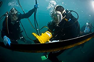 US Navy Diver instructs a Barbados coast guard diver on using a hydraulic grinder underwater Poster Print by Stocktrek Images (34 x 22)