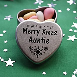 Merry Christmas Auntie Mini Heart Gift Tin with Chocolates Fits Beautifully in the palm of your hand. Great Christmas Present for Auntie Makes the perfect Stocking Filler or Card alternative. Tin Dimensions 45mmx45mmx20mm. Three designs Available, Father Christmas, Snowman and Snowflakes. They also make perfect Secret Santa Gifts.