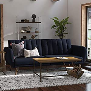 """Stylish linen upholstery wipes clean easily Ribbed tufted cushioned back with slanted oak colored wooden legs Futon Dimensions: 81.5""""L x 34.5""""W x 31.5""""H Sleeper Dimensions: 70.5""""L x 43.5""""W x 16""""H Weight Limit: 600 lb. Sturdy wood frame construction t..."""
