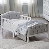 Padded and upholstered head and footboard Upholstery is...