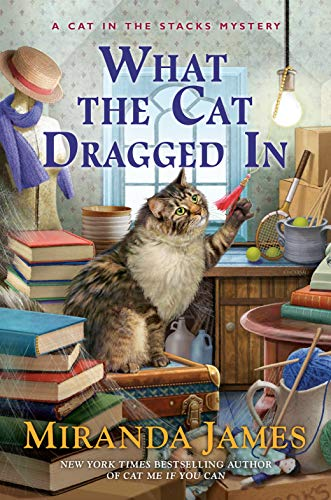What the Cat Dragged In (Cat in the Stacks Mystery Book 14)