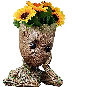 ➤ Name: Groot Action Figures Flower pot,best Christmas gift idea for your friends ➤ Commodity material:PVC. Height :6 inch. Weight:7.7 ounces ➤ Growing some succulents and flowers, making your living environment more vibrant ➤ Used as a pen holder- G...