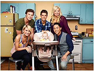 Baby Daddy Jean-Luc Bilodeau Holding Baby with Cast Smiling Around Baby in Kitchen 8 x 10 Inch Photo