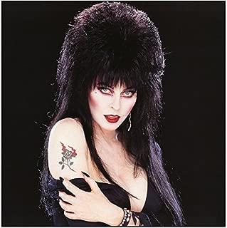 Elvira 8x10 Inch Photo Elvira: Mistress of the Dark Showing Off Shoulder Tattoo Black Background kn