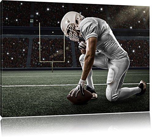 Pixxprint knieender Football-Spieler, Format: 100x70 auf Leinwand