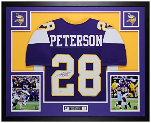 Adrian Peterson Autographed Purple Minnesota Vikings Jersey - Beautifully Matted and Framed - Hand Signed By Adrian Peterson and Certified Authentic by Beckett - Includes Certificate of Authenticity