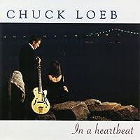 In a Heartbeat by CHUCK LOEB (2001-02-13)