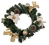 christmas wreath with white poinsettia, snow covered pine cones, gold bows and ornaments | perfect