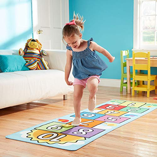 A Hopscotch Rug is a fun indoor active game for kids to burn energy while stuck indoors