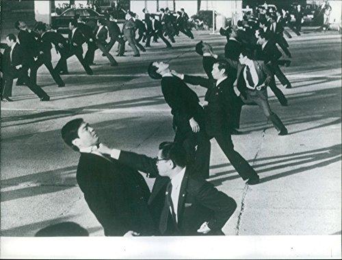 Vintage foto de policías practicar artes marciales.