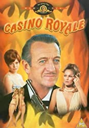 Promotional image for Casino Royale showing David Niven in centre flanked by Ursula Andress and other female cast members