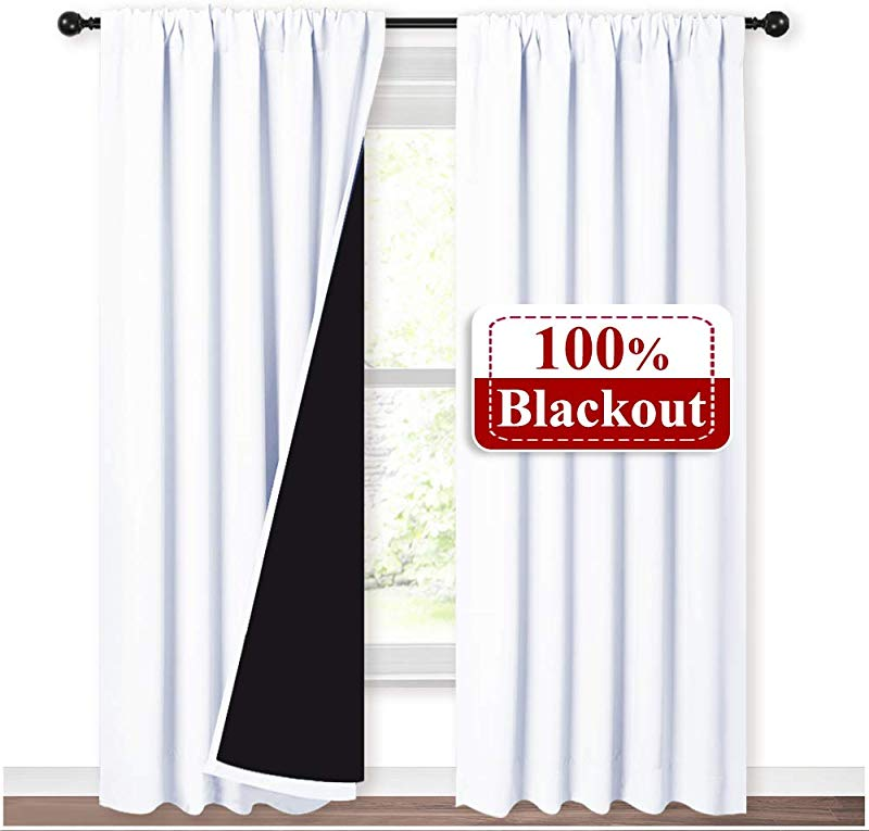 NICETOWN 100 Blackout Curtain Panels Rod Pocket Window Curtains With Black Liner For Nursery 84 Inches Drop Heat And Full Light Blocking Draperies White 2 Pieces 52 Inches Wide Each Panel