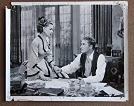 DE03 Silver River ERROL FLYNN/ANN SHERIDAN Studio Still. Here s a terrific studio still from the original release of DODGE CITY featuring a great image of ERROL FLYNN and ANN SHERIDAN. Studio Still is in FAIR condition. Multiple pinholes, no stains, no tears, but some knicks on the borders, two corners chipped. A lobby card is an 11 x 14 inch placard advertising a movie. They were displayed in the theatre lobby to entice moviegoers to go to the box office and buy a ticket.