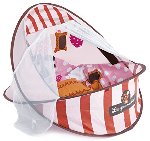 """LUDI - Petit nid nomade """"gourmandise rose"""". Dès la naissance. Lit d'appoint léger ( - de 2 kg) avec matelas épais. Se plie et se range facilement dans un sac. Fourni avec fixations au sol - 2818"""