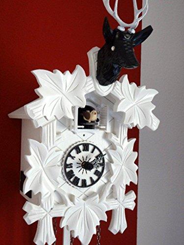 Kuckucksuhren horloge moderne design tête de cerf décorative blanc kristallaugen cLOCKVILLA hETTICH montres noir