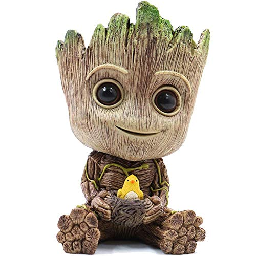 planter of Baby Groot holding a bird & it's nest