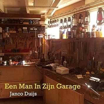 Een Man In Zijn Garage