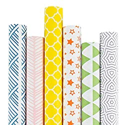 bright colorful wrapping paper in yellow green blue orange and pink